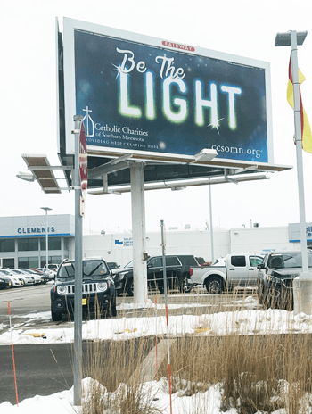 "billboard that reads ""be the light"""