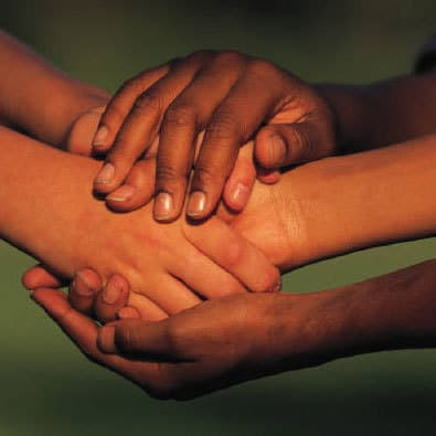 Many hands holding each other